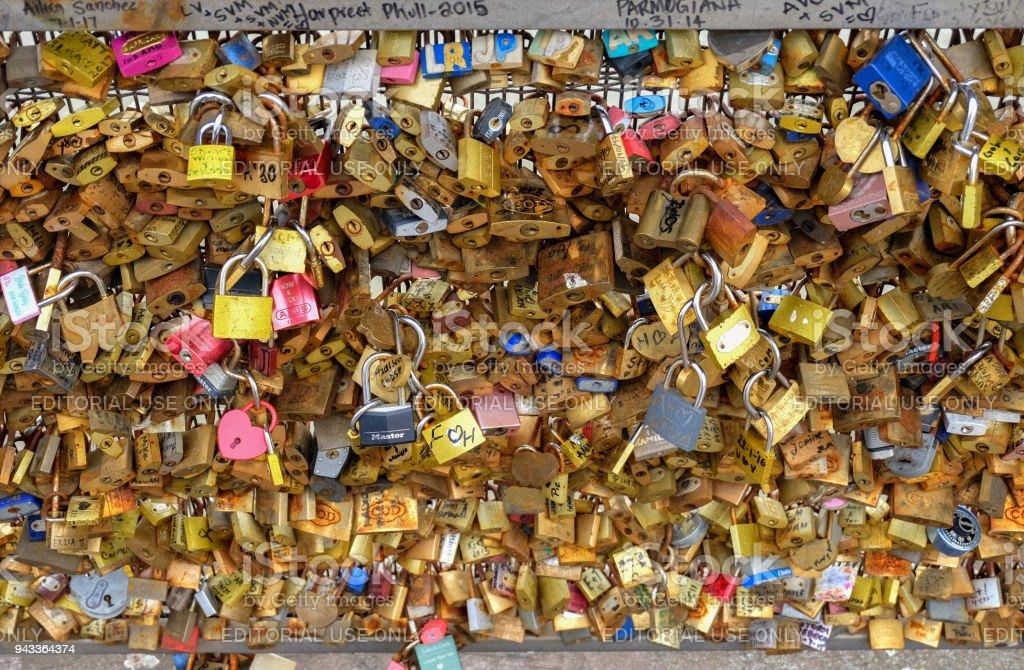 Paris, France - Pont   des Arts. Love padlocks on the bridge.   Passerelle des Arts is a pedestrian bridge in Paris which crosses the River Seine stock photo