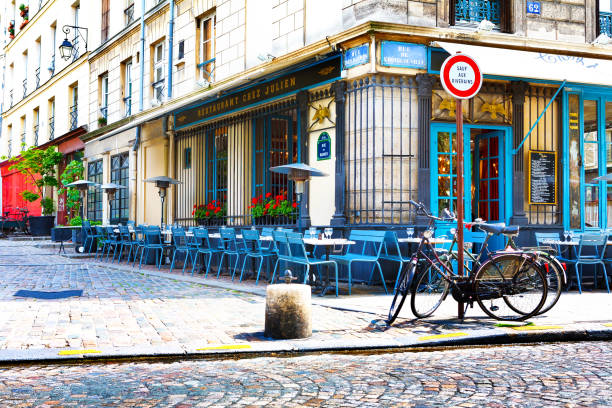 Paris, France, Restaurant Chez Julien, 12 06 2012 - empty tables and chairs on the street in the center of the city stock photo