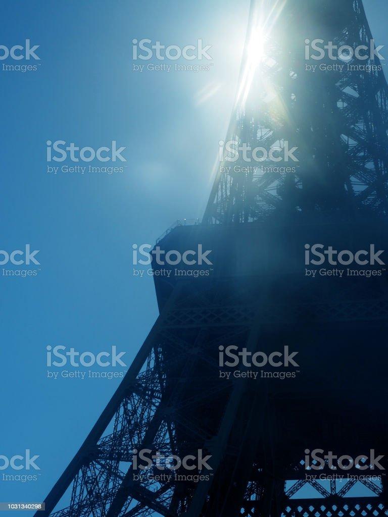 Paris, France. Sun shining through Eiffel Tower. Sun beams and spots....