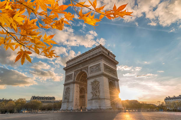 Paris France sunset city skyline at Arc de Triomphe and Champs Elysees with autumn leaf foliage stock photo