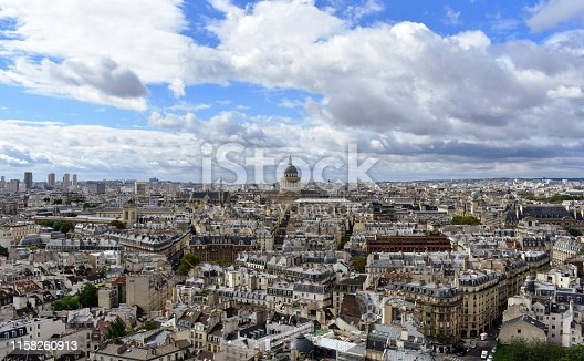 Latin Quarter, Paris, France. Panoramic view from a viewpoint. The Pantheon and Saint Etienne du Mont Eglise. Blue sky with clouds.