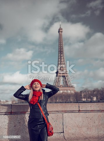 so relaxed and happy woman with Eiffel Tower in background enjoying city break.