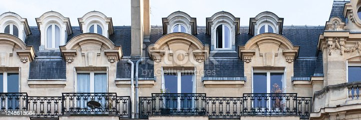 istock Paris House with chimney and windows. Haussmann epoque, beautiful balconies, traditional french building. Banner 1248613664