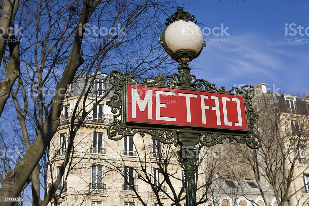 Paris Metro Underground Subway Sign and Apartment Building royalty-free stock photo