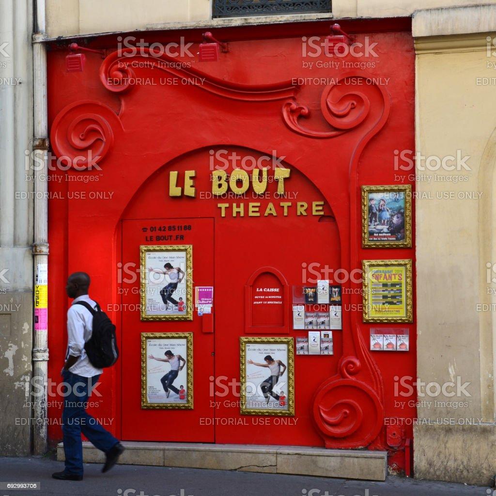 Paris, Montmartre -A tourist strolling past the Facade of Le Bout Theatre stock photo