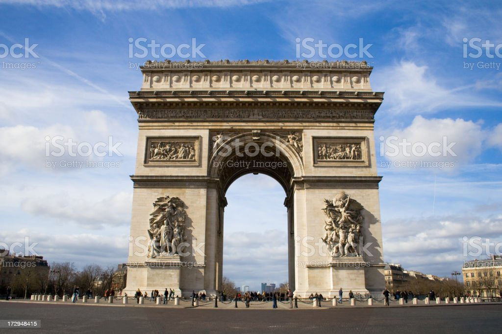 Paris Monument under a cloudy blue sky along a paved street stock photo