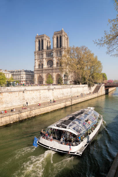 Paris, Notre Dame cathedral with boat on Seine in France stock photo