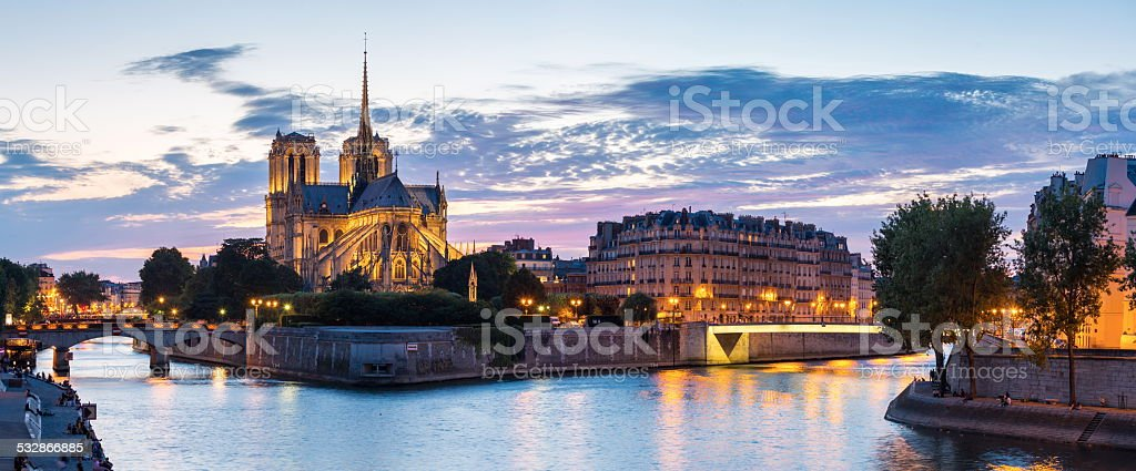 Paris Notre Dame Panorama Panorama of Notre Dame Cathedral with Paris cityscape at dusk, France 2015 Stock Photo