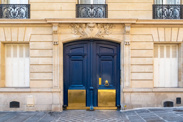 Paris, old wooden door Paris, old wooden door boulevard des Batignolles, beautiful entry porch former stock pictures, royalty-free photos & images