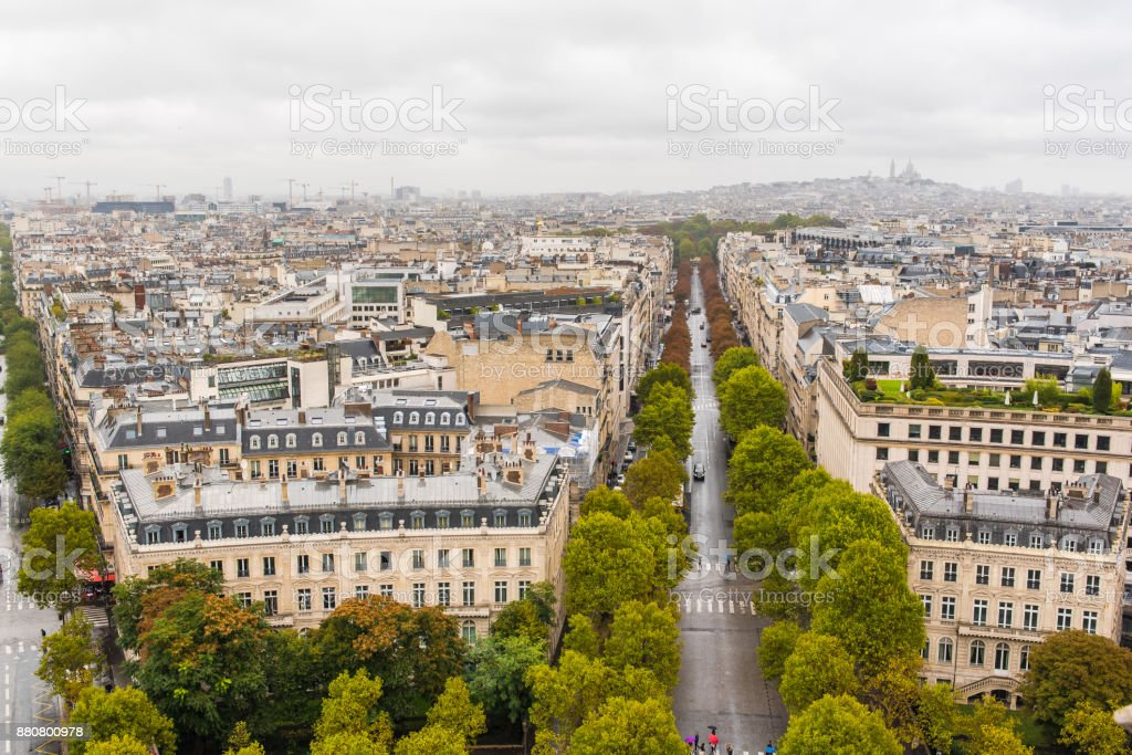 Paris, panorama from Arc de Triomphe in a rainy day stock photo