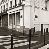 """Crossroad between Rue des Arquebusiers and Boulevard Beaumarchais in the 3rd """"arrondissement"""", with pedestrian crossing. the street names and the shops have been made anonymous here. Scan from 120-Ilford HP5+"""