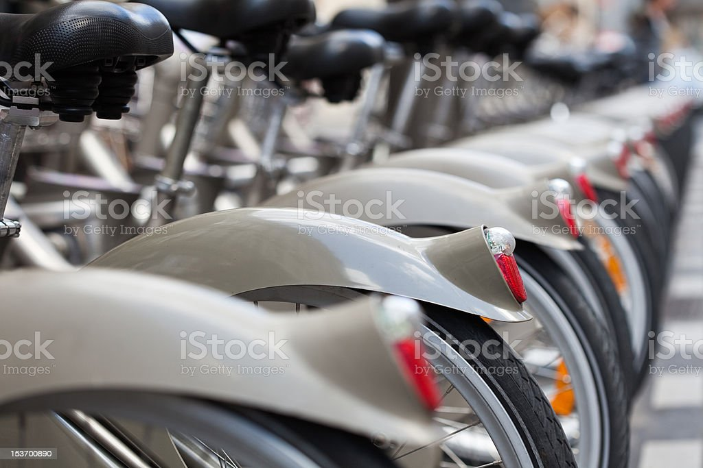 Paris rent-bikes parked in a row. royalty-free stock photo
