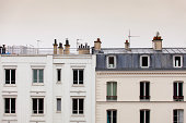 Very high key photograph of two buildings near Montmartre in Paris, France