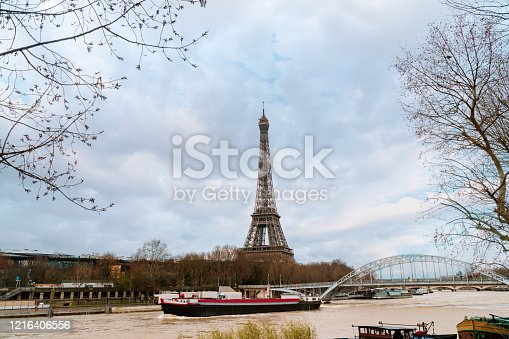 Paris Seine view with Eiffel tower and ship at autumn. Horizontal composition.