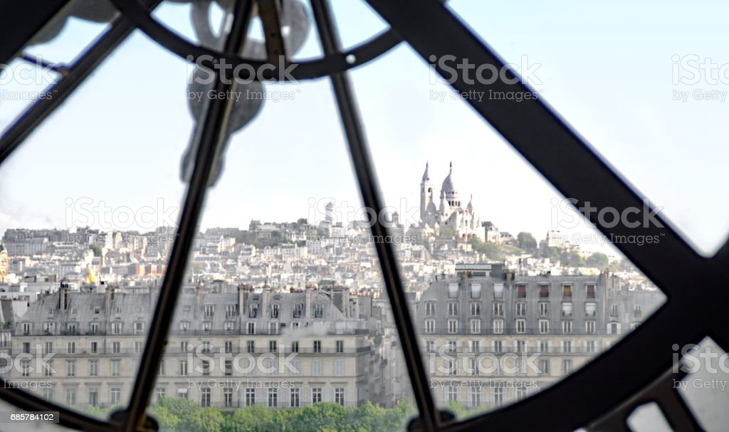 Paris skyline view through the hands of a clock royalty-free stock photo