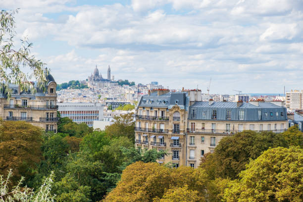Paris skyline with Montmartre hill and Sacre Coeur Basilica in view. stock photo