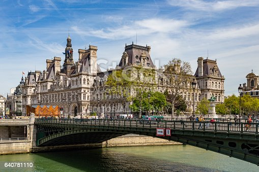 Paris, France - May 2, 2016: Outdoor scene of the River Seine running through Paris on a sunny day with the Pont D'Arcole and Paris Town Hall