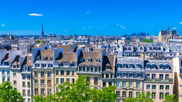 Paris, typical roofs in the Marais Paris, typical roofs in the Marais, aerial view with the Eiffel Tower, the Saint-Eustache church and the Defense in background ile de france stock pictures, royalty-free photos & images