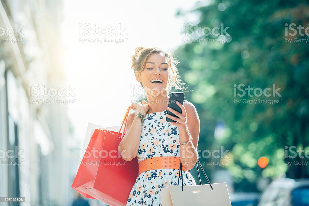 Paris, Woman shopping on Avenue Montaigne royalty-free stock photo