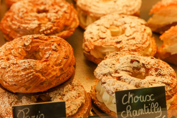 Paris-brest french cake with cream at the patisserie shop in France Paris-brest french cake with cream at the patisserie shop in France picardy stock pictures, royalty-free photos & images