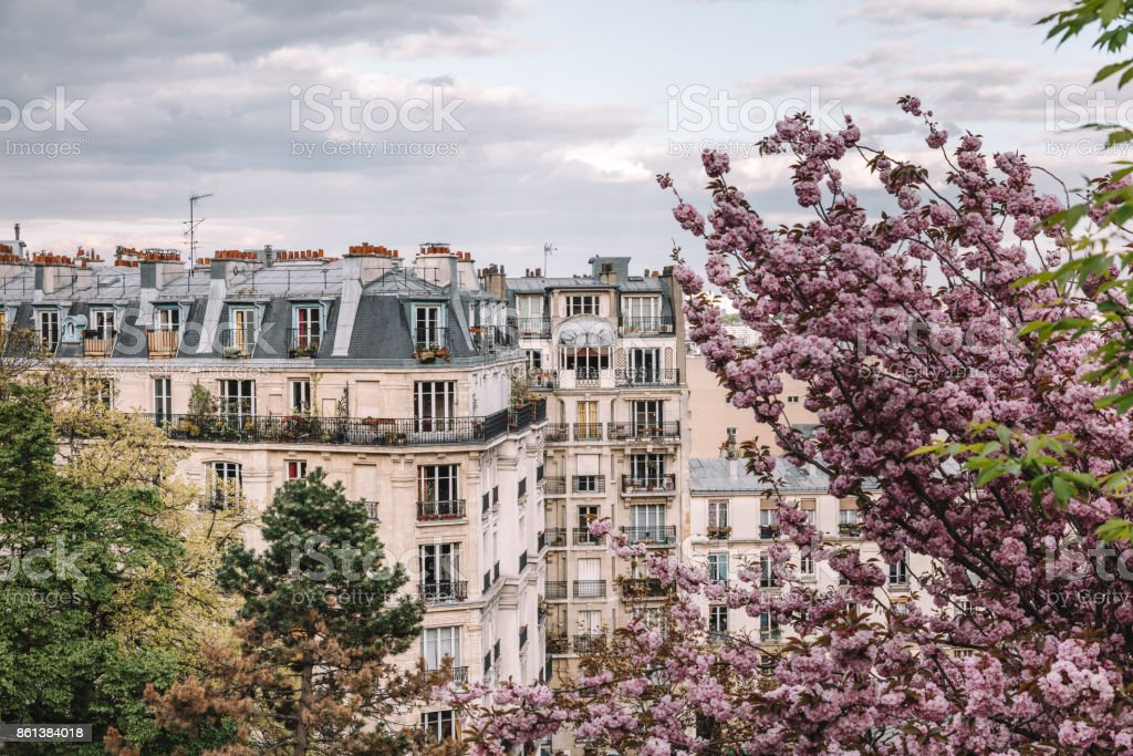 Parisian apartment building in spring stock photo