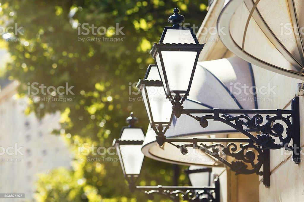 Parisian awnings and street lanterns back lit stock photo