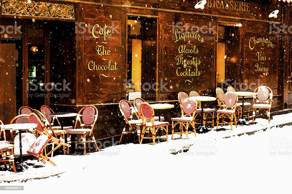 Parisian café under snowfall stock photo