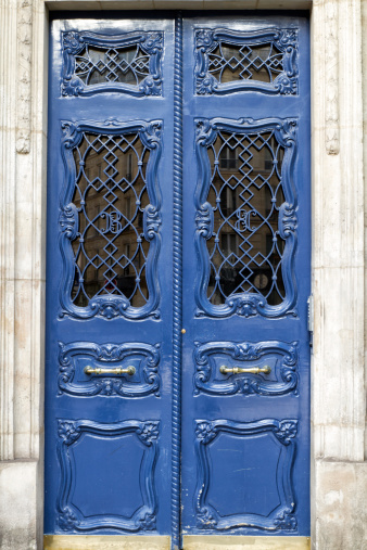 Parisian Front Door With Reflections Building In The Window Stock Photo - Download Image Now