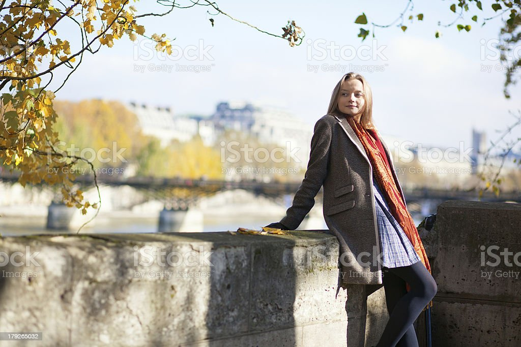Parisian girl on the embankment royalty-free stock photo