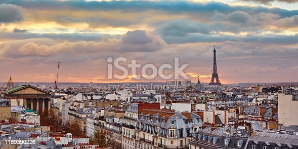 Beautiful Parisian skyline with the Eiffel tower with dramatic colorful sunset