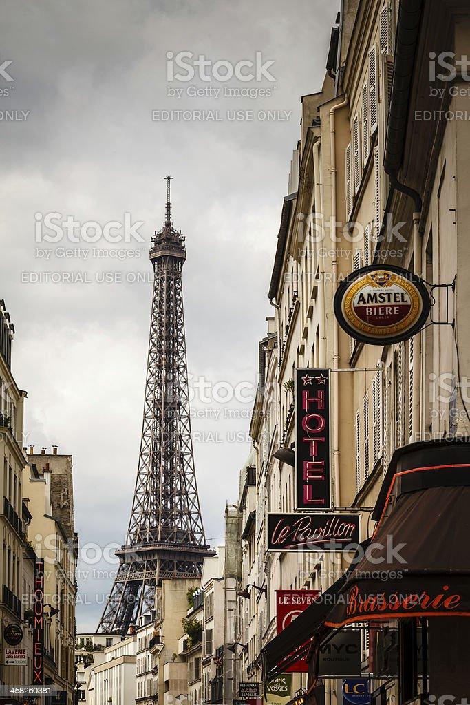 Parisian Street against Eiffel Tower in Paris, France stock photo