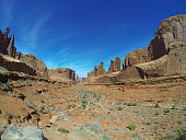 Low angle view of the South Window of Arches National Park outside of Moab, Utah.