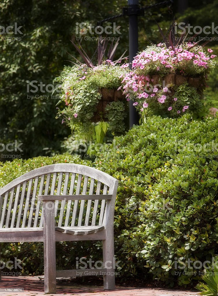 Park Bench and Hanging Baskets royalty-free stock photo
