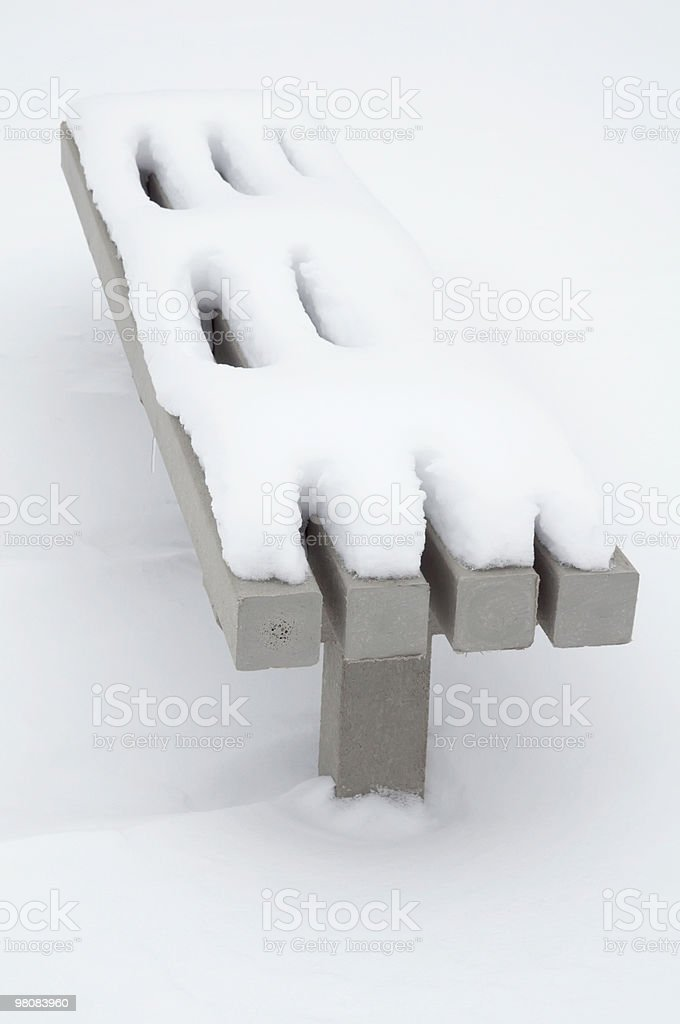 Park bench covered with snow royalty-free stock photo