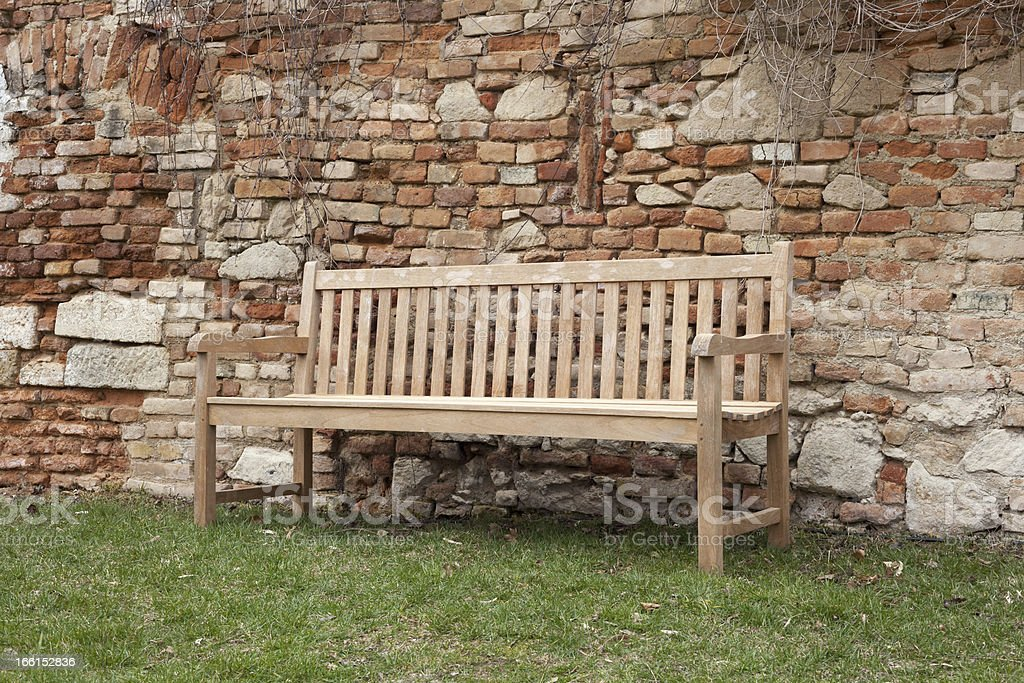 Park bench in the garden royalty-free stock photo