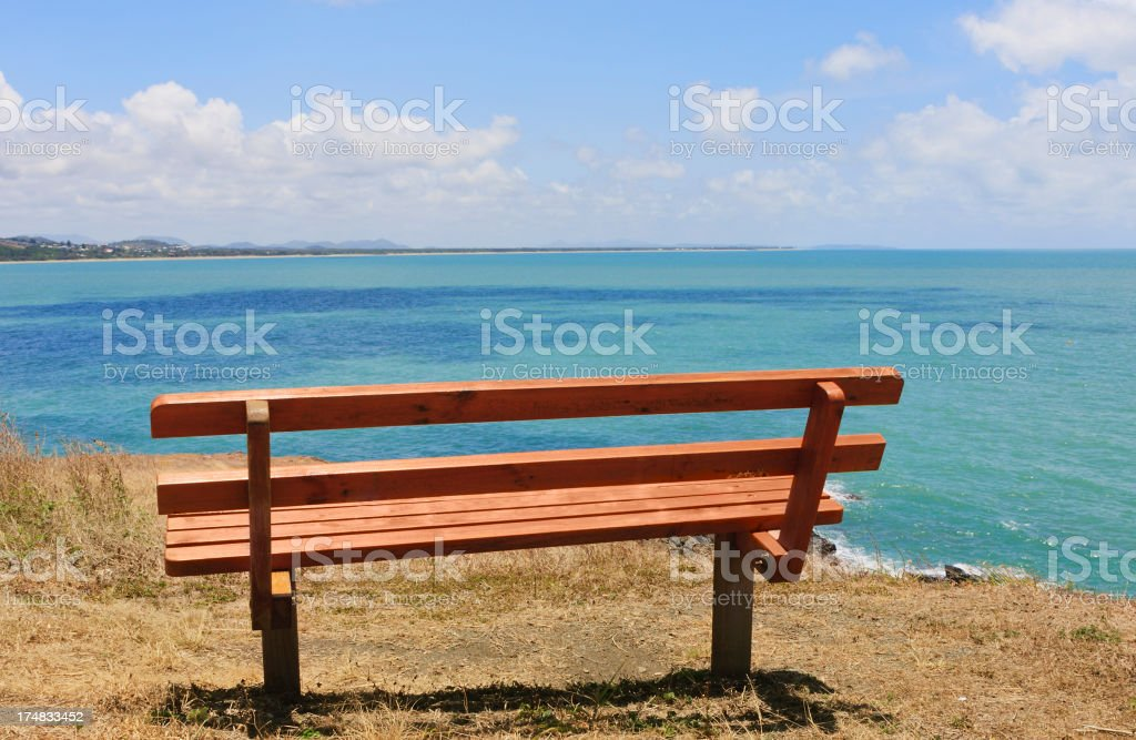Park bench on the headland looking out to sea royalty-free stock photo