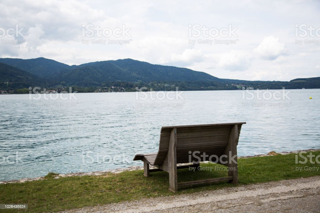 Park bench on the Tegernsee, sunbed stock photo