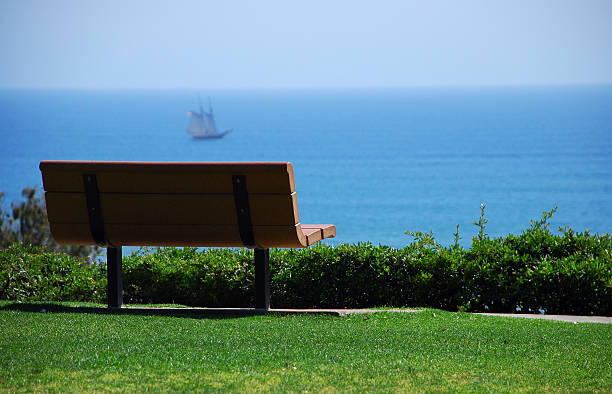 Park bench with a great view of the ocean. stock photo