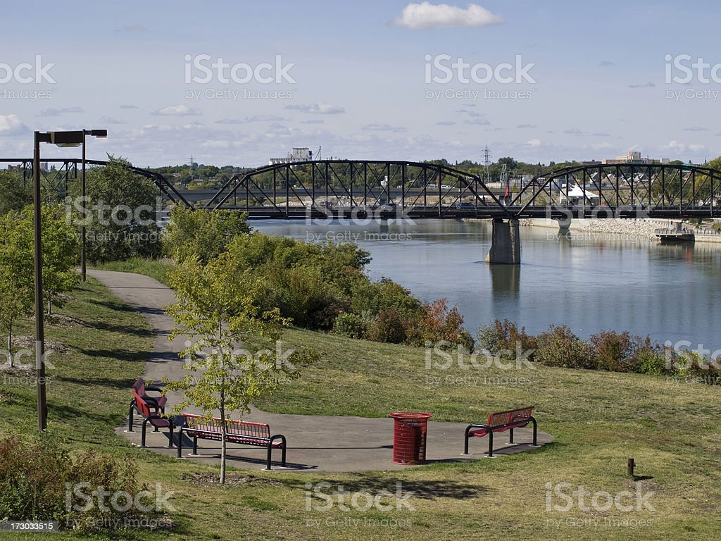 Park Benches and Bridge in Downtown Saskatoon royalty-free stock photo