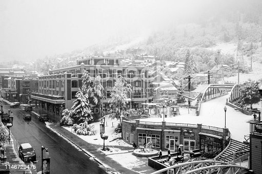 Park city,Utah USA - October 10, 2018 : Morning street shot of Park City Utah after an early Autumn snow storm blankets the city. Park City was a small mining town in 1800's . Now it is one of the best ski resort town in Utah. Also known for the Sundance Film Festival in every January. Bus trollies go up and down Main Street and provides free public transportation to everyone.