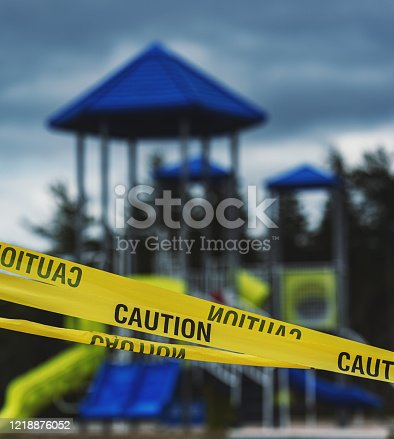 Yellow caution tape blocks a public park/playground during the ongoing COVID-19 pandemic.