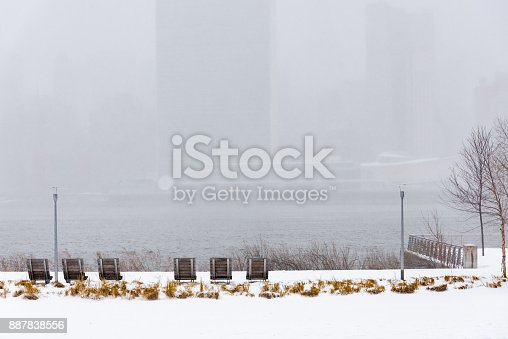 istock Park covered with snow during the Winter Storm Stella in New York City with view of United Nations Building in the background. 887838556