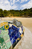 Park Guell in Barcelona. Perspective view of the famous balcony made of mosaics.
