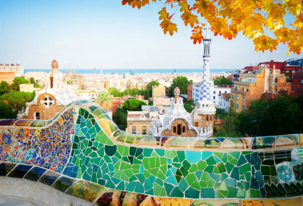 park Guell, Barcelona Gaudi bench and cityscape of Barcelona from park Guell, famous view of Barcelona, Spain at fall unesco stock pictures, royalty-free photos & images