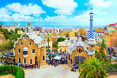 istock Park Guell in Barcelona. View to entrace houses with mosaics on foreground, Spain. 949462588