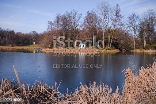 Pszczyna, Poland, 9th of February, 2020: Park lake of Pszczyna Castle also known as Pless Castle.