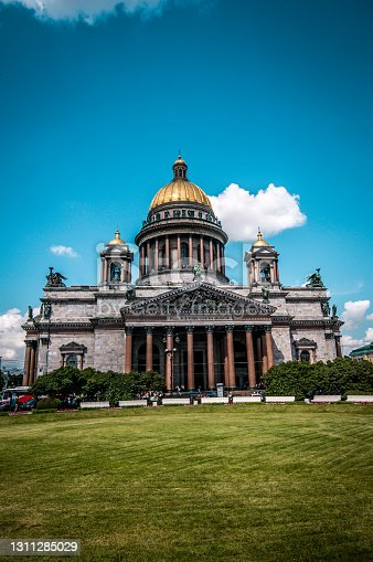 Park Near St. Isaac's Cathedral And Vehicles In Front Of It Saint Petersburg, Russia