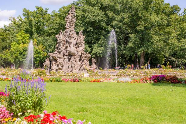 Park of the castle Schloss Erlangen Erlangen: Public park of the castle Schloss Erlangen, Germany on August 20, 2017.  The castle was built in the year 1700. erlangen stock pictures, royalty-free photos & images