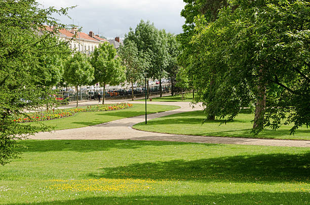 Park Park with green grass and tree in Nancy, Lorraine, France. grand est stock pictures, royalty-free photos & images