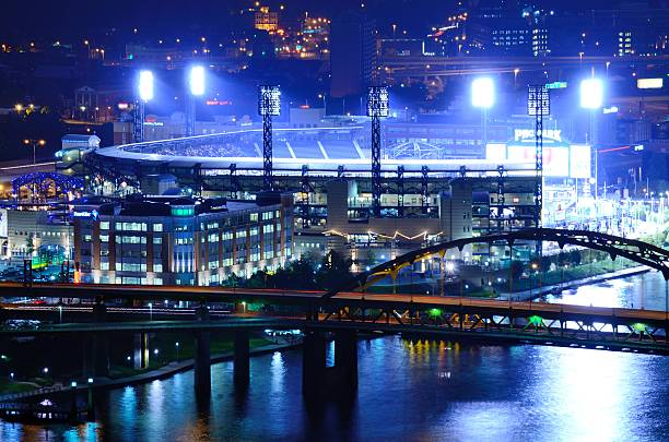 PNC Park Pittsburgh, Pennsylvania, USA - August 7, 2012: Exterior of PNC Park and the Roberto Clemente Bridge. Opened in 2001, it is the 5th home of the Pirates. major league baseball stock pictures, royalty-free photos & images